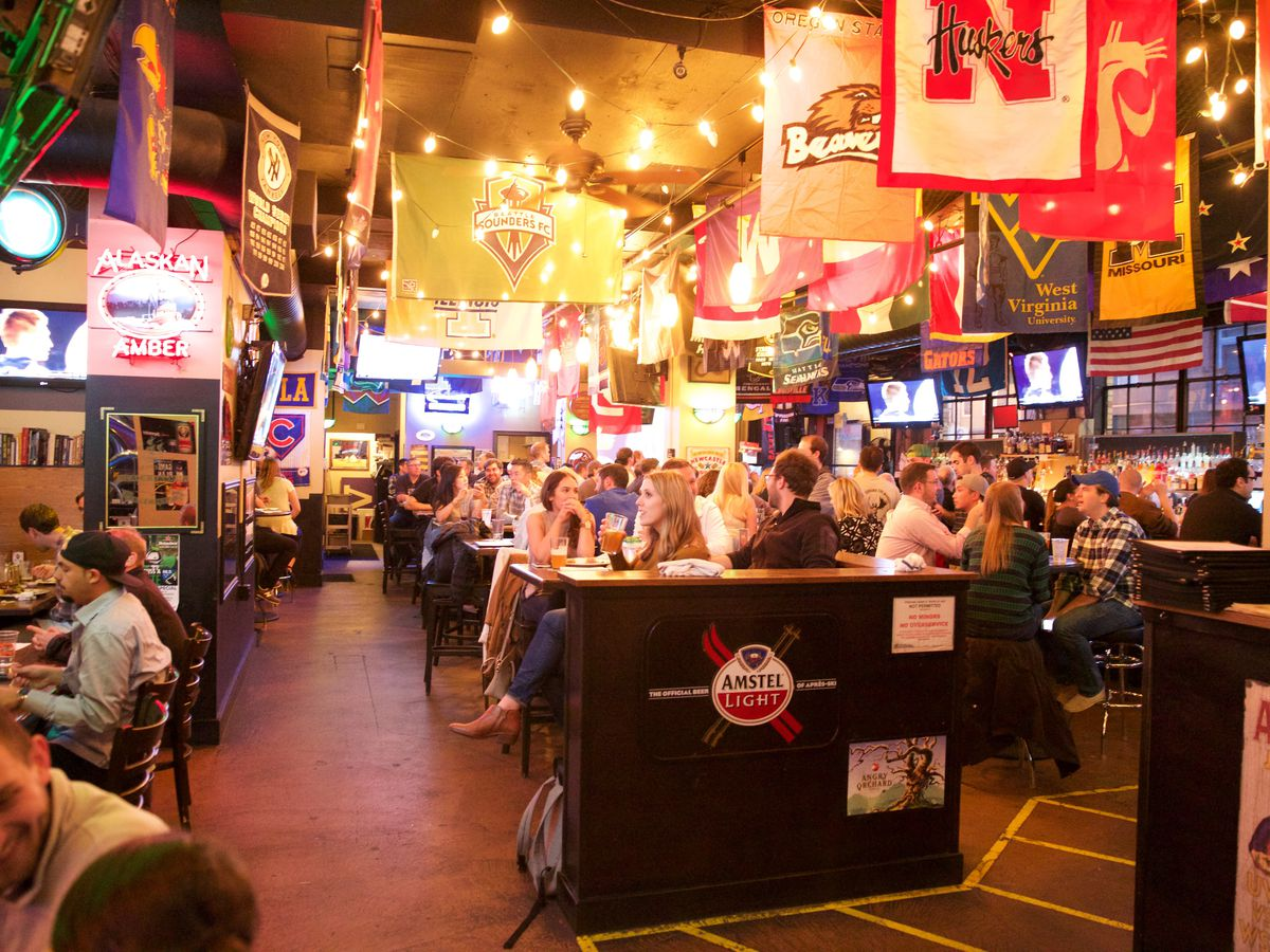 A view inside Buckley's in Belltown, where sports banners hang from the ceiling.
