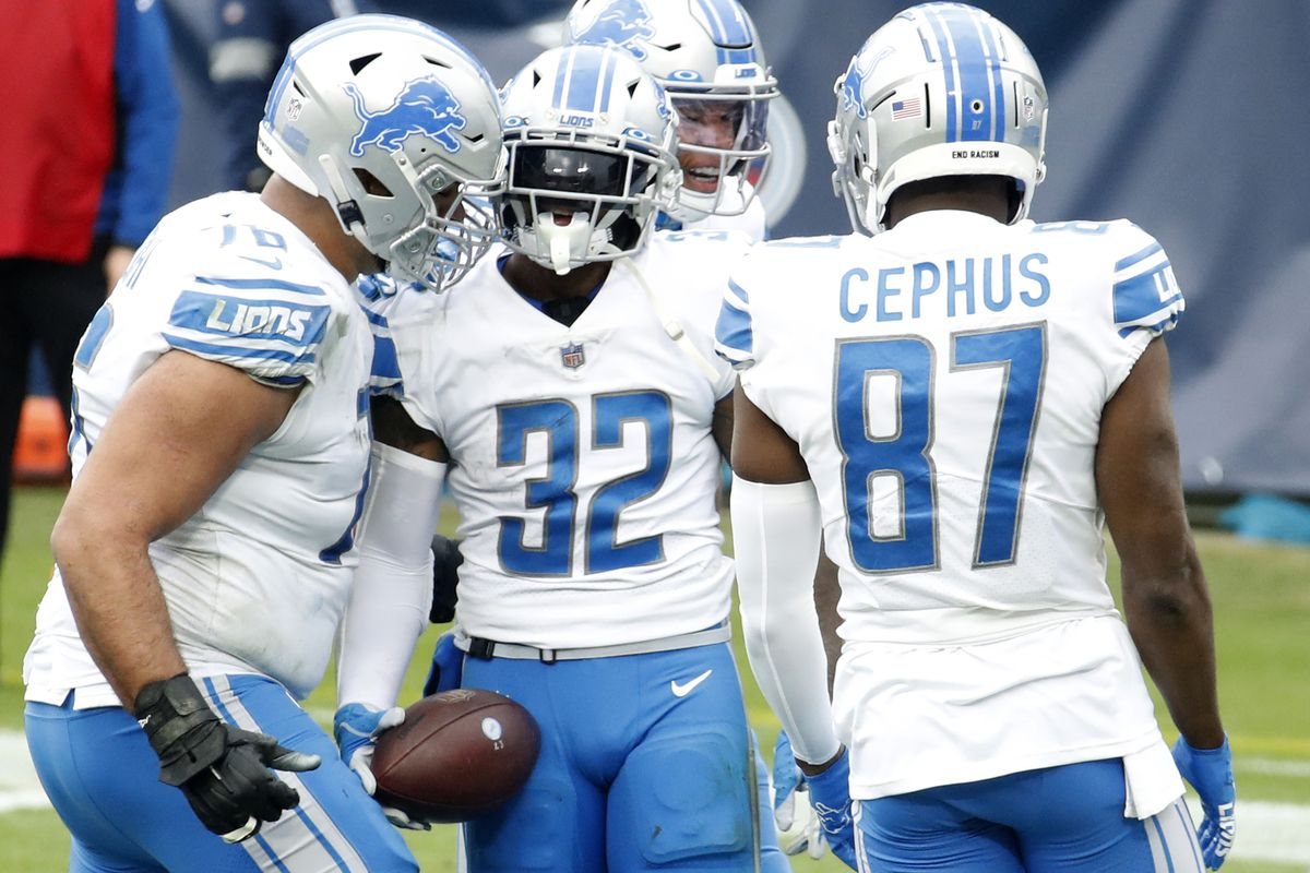 Running back D'Andre Swift #32 of the Detroit Lions celebrates with teammates after rushing for a touchdown over the Tennessee Titans during the second quarter of the game at Nissan Stadium on December 20, 2020 in Nashville, Tennessee.