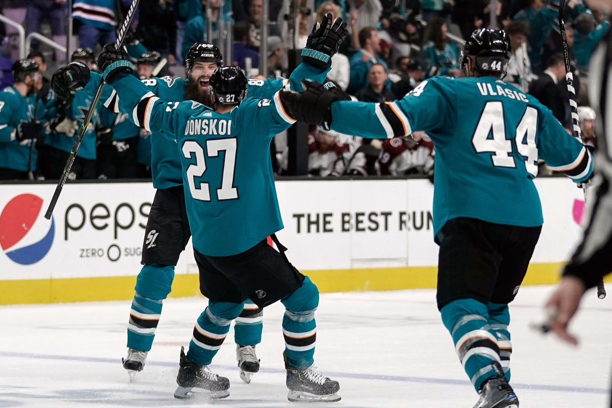 San Jose Sharks right wing Joonas Donskoi celebrates with defenseman Brent Burns and defenseman Marc-Edouard Vlasic against the Colorado Avalanche during the second period in Game 7 of the second round of the 2019 Stanley Cup Playoffs at SAP Center.