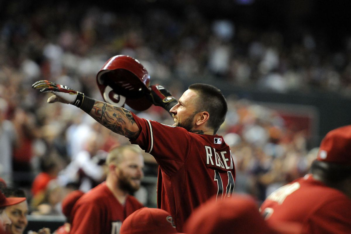 PHOENIX, AZ - JUNE 20:  Ryan Roberts #14 of the Arizona Diamondbacks waves to the fans after scoring on an in-the-park home run against the Seattle Mariners at Chase Field on June 20, 2012 in Phoenix, Arizona.  (Photo by Norm Hall/Getty Images)
