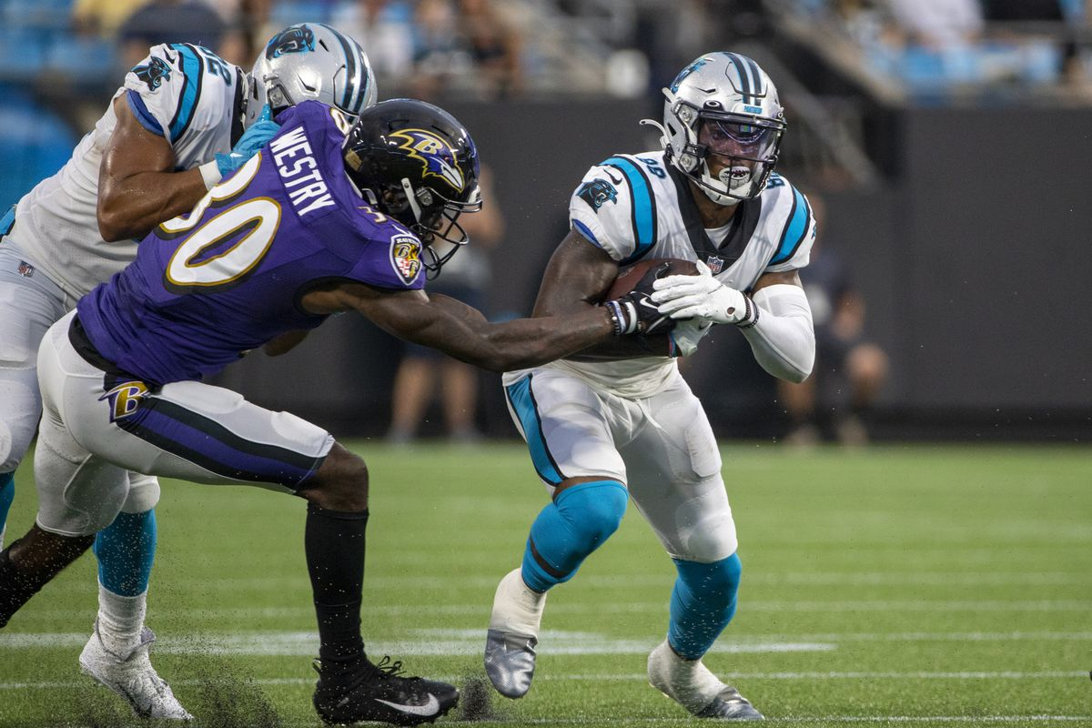 Terrace Marshall Jr. #88 of the Carolina Panthers runs the ball against the Baltimore Ravens during the first half of a NFL preseason game at Bank of America Stadium on August 21, 2021 in Charlotte, North Carolina.