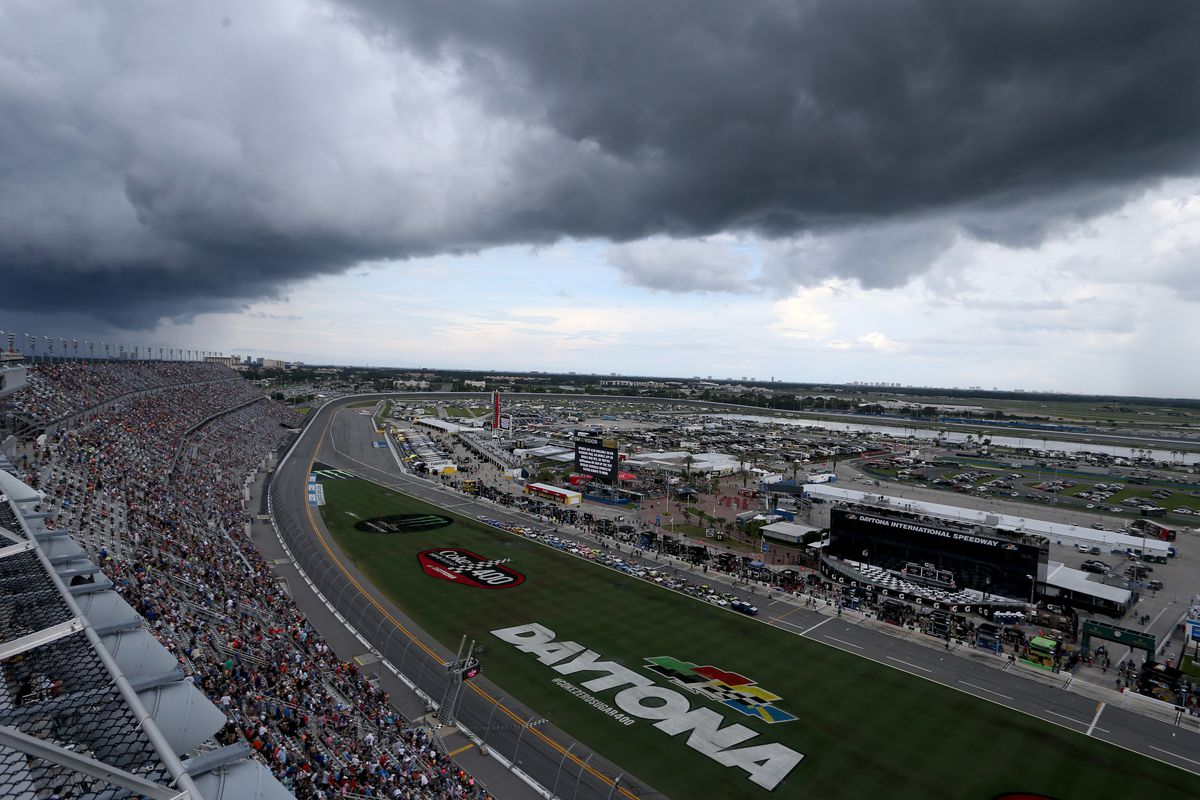 Storm clouds and weather brings the cars to pit road during the Monster Energy NASCAR Cup Series Coke Zero Sugar 400 at Daytona International Speedway on July 07, 2019 in Daytona Beach, Florida.