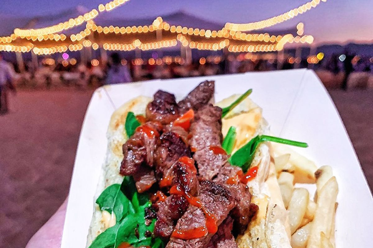 A Picanha Steak Truck sandwich with fries.