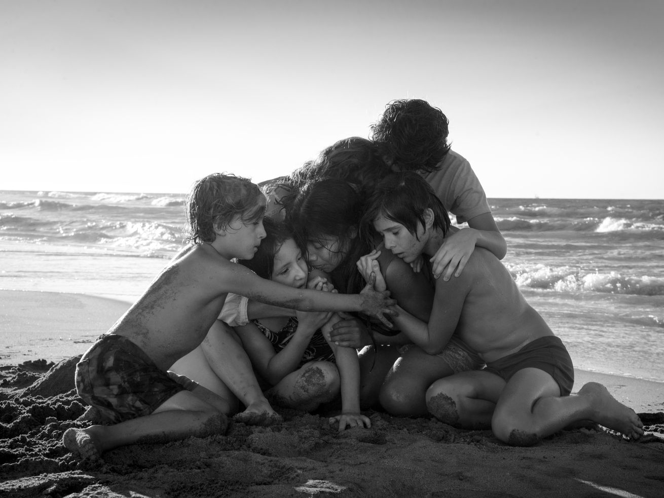 Yalitza Aparicio (center) is at the heart of Roma, written and directed by Alfonso Cuarón.
