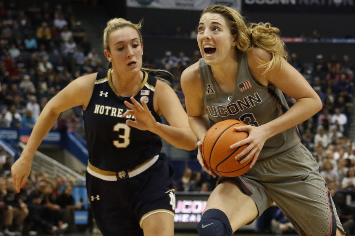 UConn�s Katie Lou Samuelson (33) drives past Notre Dame's Marina Mabrey (3) during the Notre Dame Fighting Irish vs UConn Huskies women's college basketball game in the Women's Jimmy V Classic at the XL Center in Hartford, CT on December 3, 2017.