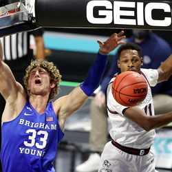 Brigham Young Cougars forward Caleb Lohner (33) has his shot knocked away by Gonzaga Bulldogs guard Joel Ayayi (11) as BYU and Gonzaga play in the finals of the West Coast Conference tournament at the Orleans Arena in Las Vegas on Tuesday, March 9, 2021.