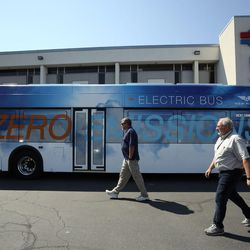 Troy Fillerup and Dave Merrill walk around a model bus outside the Utah Transit Authority offices in Salt Lake City on Tuesday, Aug. 2, 2016. The bus is similar to five new zero-emission battery-electric buses from New Flyer that will be used in Salt Lake City. The Utah Transit Authority has received a $5.4 million low- or no-emission vehicle deployment grant from the Federal Transit Administration.