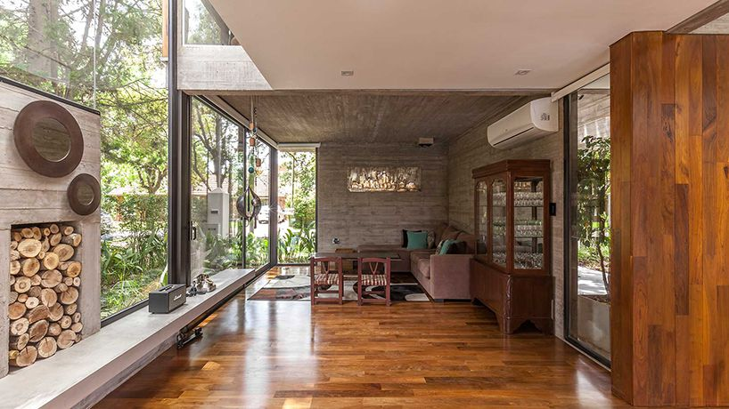 Modern concrete and wood house was designed around existing ... on natural wood exterior paint color, natural wood interior design, natural wood kitchen ideas, natural wood texture background,