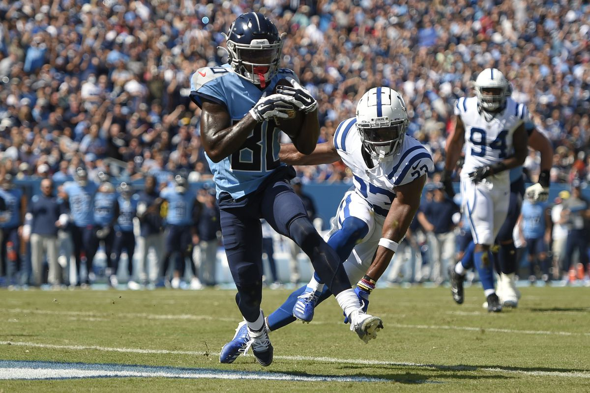 Tennessee Titans wide receiver Chester Rogers (80) scores a touchdown past Indianapolis Colts cornerback Kenny Moore II (23) during the first half at Nissan Stadium.