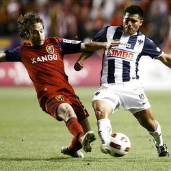 Ned Grabavoy of Real Salt Lake fights for control of the ball against Osvaldo Martinez from the Rayados of Monterrey during the final game of the CONCACAF championship at Rio Tinto Stadium in Sandy Wednesday, April 27, 2011.