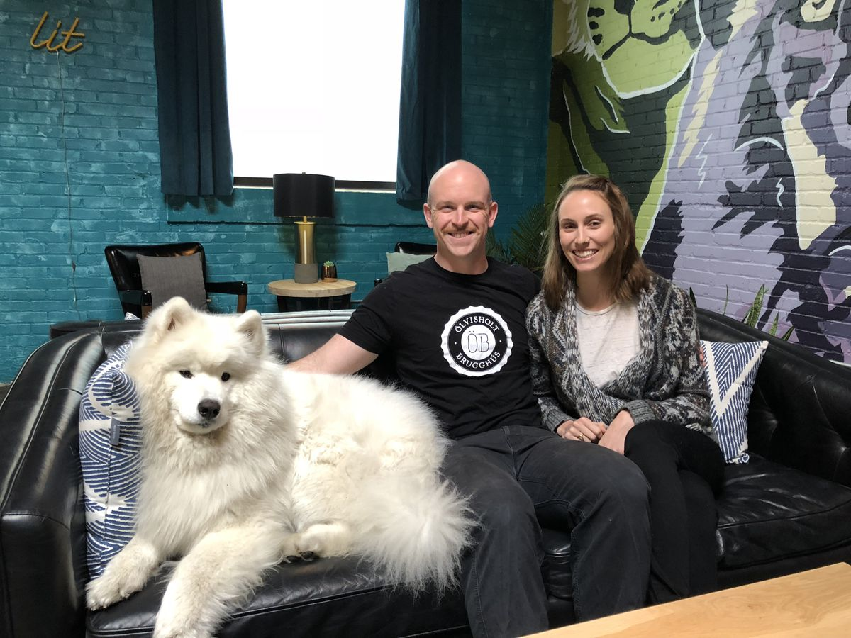 Lamplighter founders AC Jones and Cayla Marvil with their dog, Barley