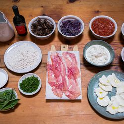 The ingredients: <br> Top row, left to right: Yeast, NYC tap water, olive oil, mushroom mix (cremini, king trumpet, oyster), red onions, tomato sauce, anchovies. <br> Middle row, left to right: Salt, 00 flour, house cured prosciutto,  stracciatella, Cal