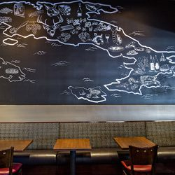 A tour of Italian food on the map of Italy on the wall at Il Gaillo.
