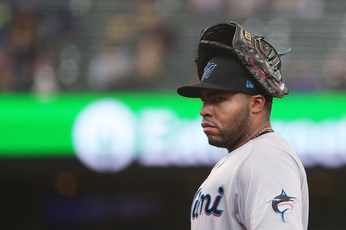 Jesus Aguilar #24 of the Miami Marlins stands at first base during a game against the Milwaukee Brewers at American Family Field on April 28, 2021 in Milwaukee, Wisconsin.