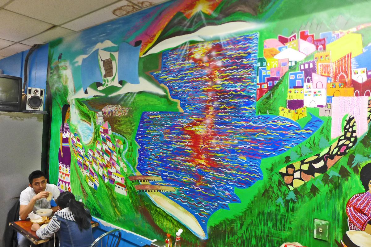 A colorful mural decorates the dining room of Karen Deli.