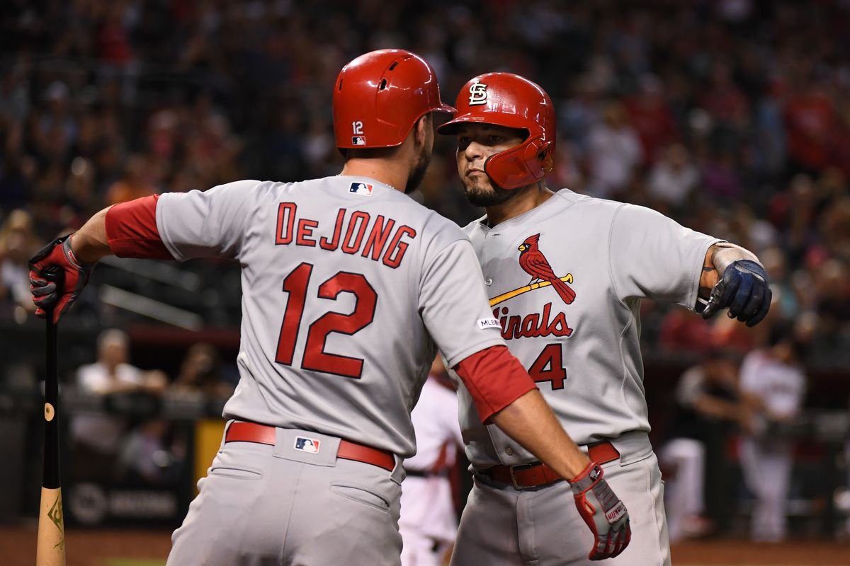 Yadier Molina of the St. Louis Cardinals celebrates with Paul DeJong after hitting a two run home run off of Alex Young of the Arizona Diamondbacks during the fifth inning at Chase Field on September 23, 2019 in Phoenix, Arizona.