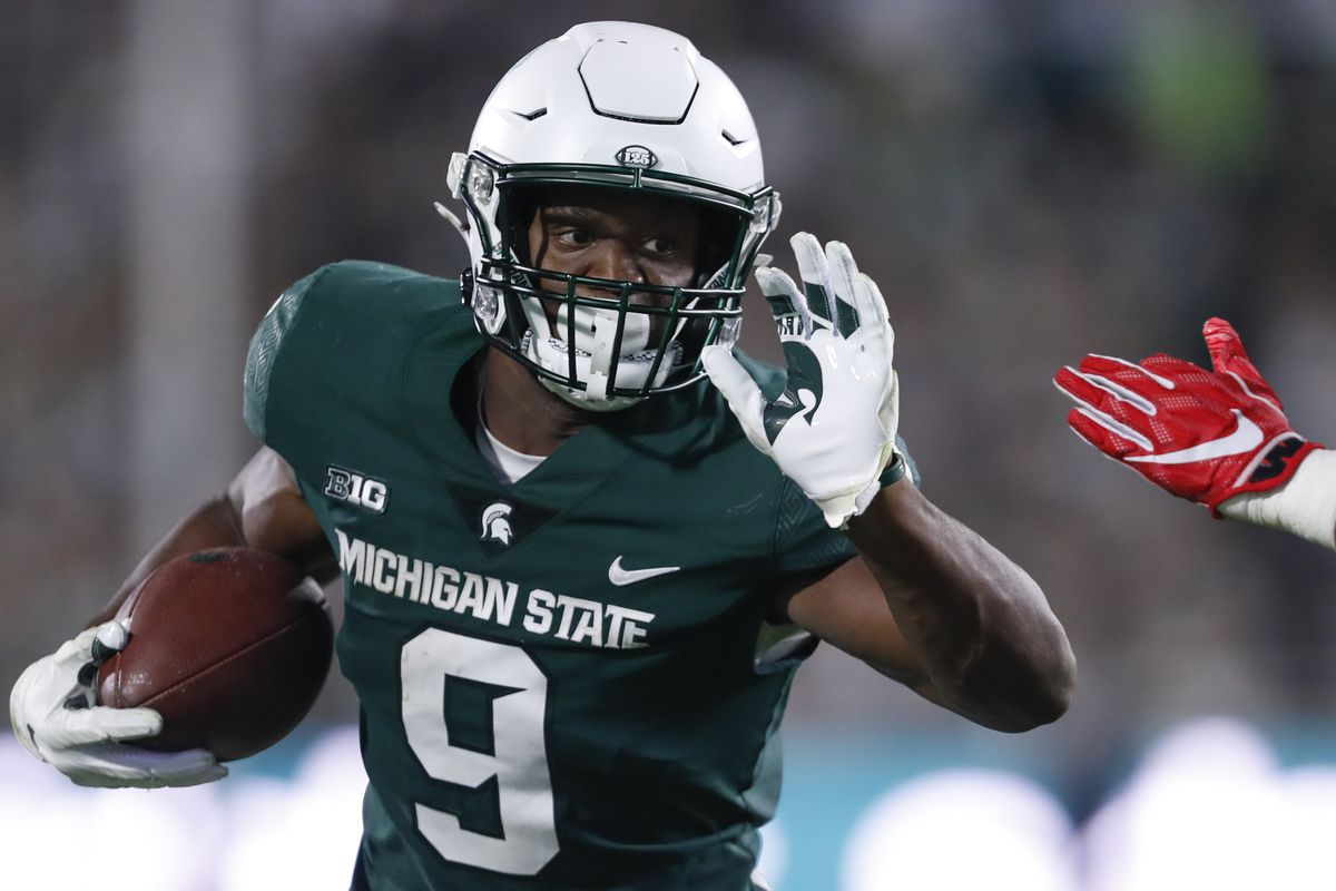 Michigan State Spartans running back Kenneth Walker III runs for a touchdown during the second quarter against the Western Kentucky Hilltoppers at Spartan Stadium.