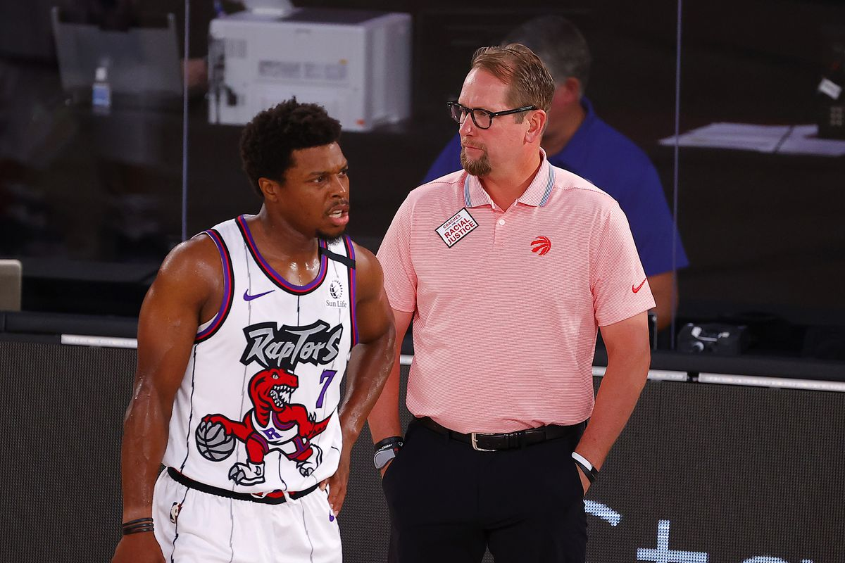 Nick Nurse of the Toronto Raptors talks with Kyle Lowry of the Toronto Raptors during the first quarter against the Memphis Grizzlies at Visa Athletic Center at ESPN Wide World Of Sports Complex.