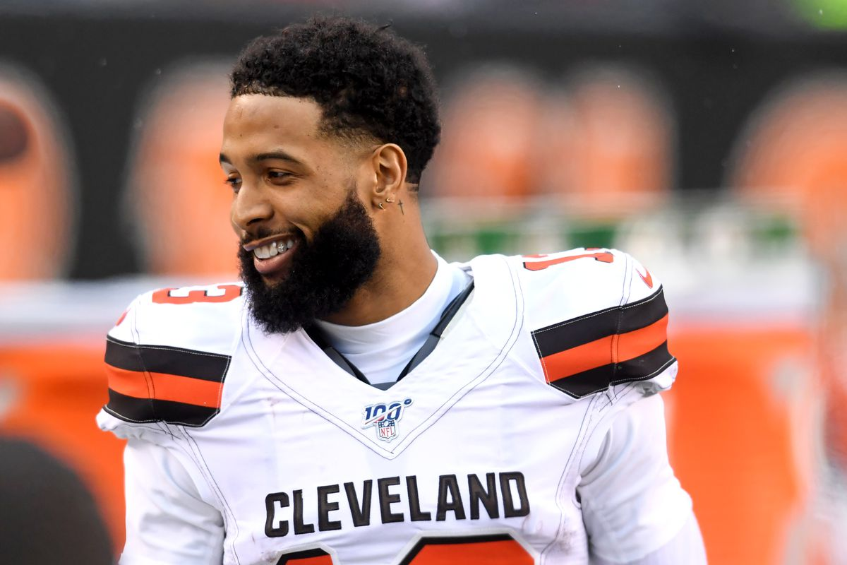 Wide receiver Odell Beckham Jr. of the Cleveland Browns laughs as he paces the sideline in the fourth quarter of a game against the Cincinnati Bengals on December 29, 2019 at Paul Brown Stadium in Cincinnati, Ohio. Cincinnati won 33-23.