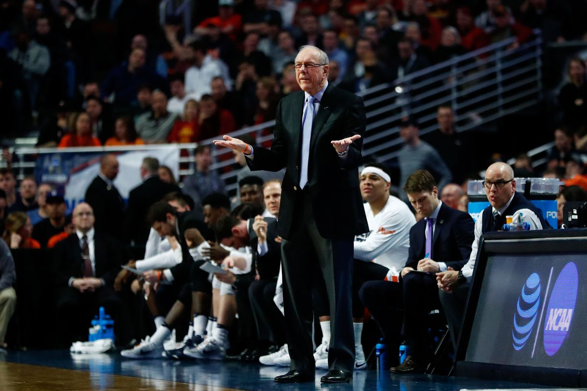 Syracuse Orange head coach Jim Boeheim reacts to action on the court by shrugging in disbelief