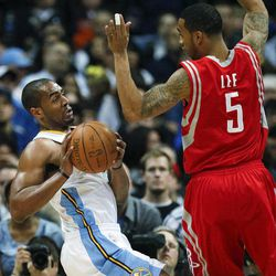 Denver Nuggets shooting guard Arron Afflalo (6) tries to maneuver around Houston Rockets shooting guard Courtney Lee (5) during the first quarter of an NBA basketball game Sunday, April 15, 2012, in Denver.