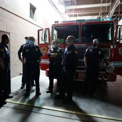 Firefighters gather before the Light the Night ceremony at Unified Fire Station 124 in Riverton on Monday, Sept. 28, 2020.