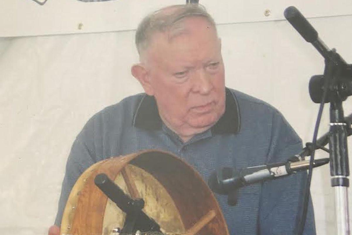Malachy Towey with a bodhran, a traditional Irish drum.
