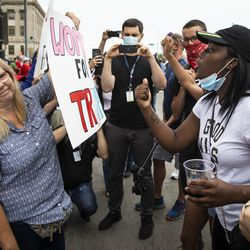 Supporters of President Donald Trump and Black Lives Matter protesters argue and shout over each other outside of the Kenosha County Courthouse, in anticipation of the president's arrive in the Wisconsin city, Tuesday afternoon, Sept. 1, 2020.