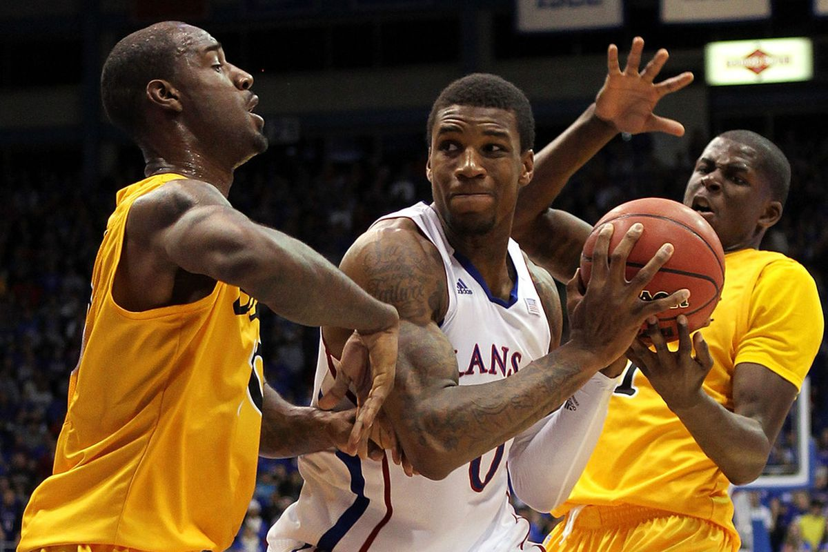 LAWRENCE, KS - DECEMBER 06:  Thomas Robinson #0 of the Kansas Jayhawks controls the ball during the game against the Long Beach State 49ers on December 6, 2011 at Allen Fieldhouse in Lawrence, Kansas.  (Photo by Jamie Squire/Getty Images)
