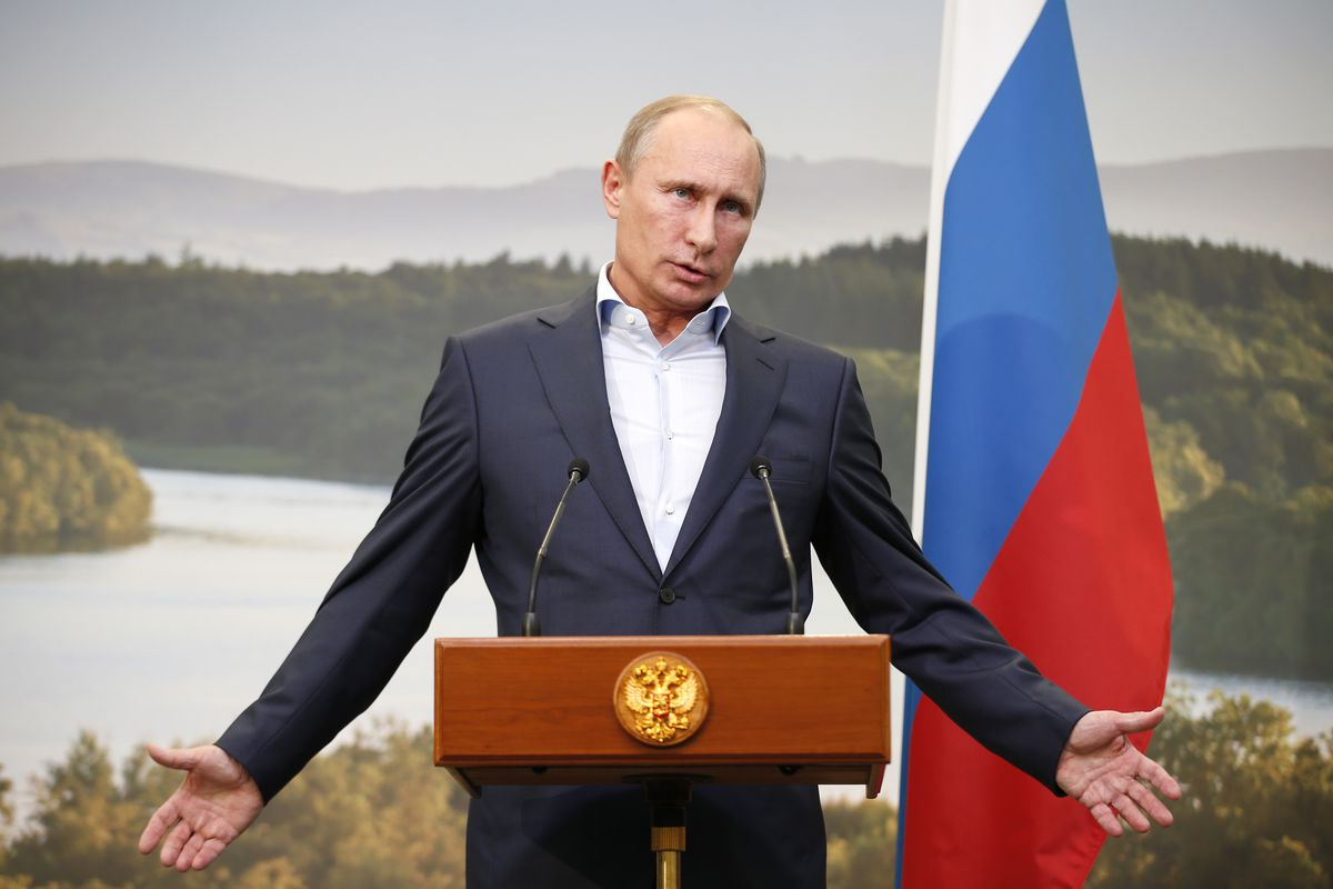A picture of Russian President Vladimir Putin behind a podium