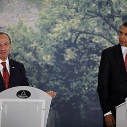 President Barack Obama, right, listens as Mexico's President Felipe Calderon talks during a joint press conference with Canada's Prime Minister Stephen Harper at the Cabanas Cultural Center in Guadalajara, Mexico, Monday.