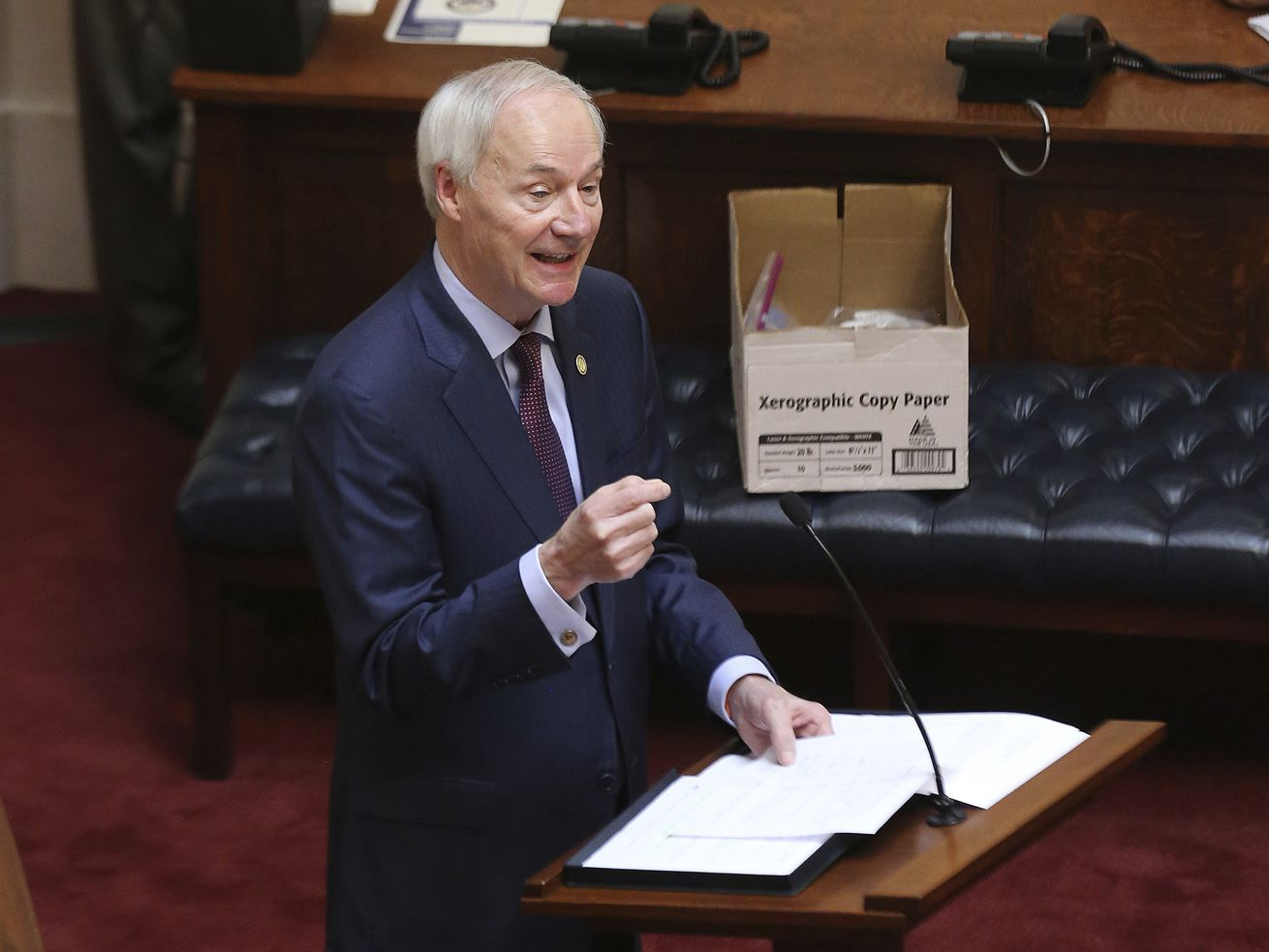 In this April 8, 2020 photo, Arkansas Gov. Asa Hutchinson gives the State of the State in the senate chamber of the state Capitol in Little Rock, Ark. Hutchinson vetoed legislation that would have made his state the first to ban gender confirming treatments for transgender youth.