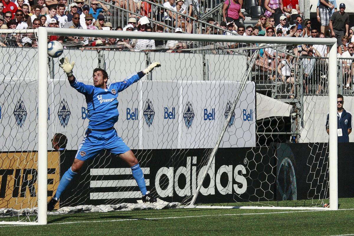 VANCOUVER, CANADA - AUGUST 27: Tally Hall #1 of the Houston Dynamo redirects the ball off a post during their MLS game August 27, 2011 at Empire Field in Vancouver, British Columbia, Canada. Vancouver won 1-0. (Photo by Jeff Vinnick/Getty Images)