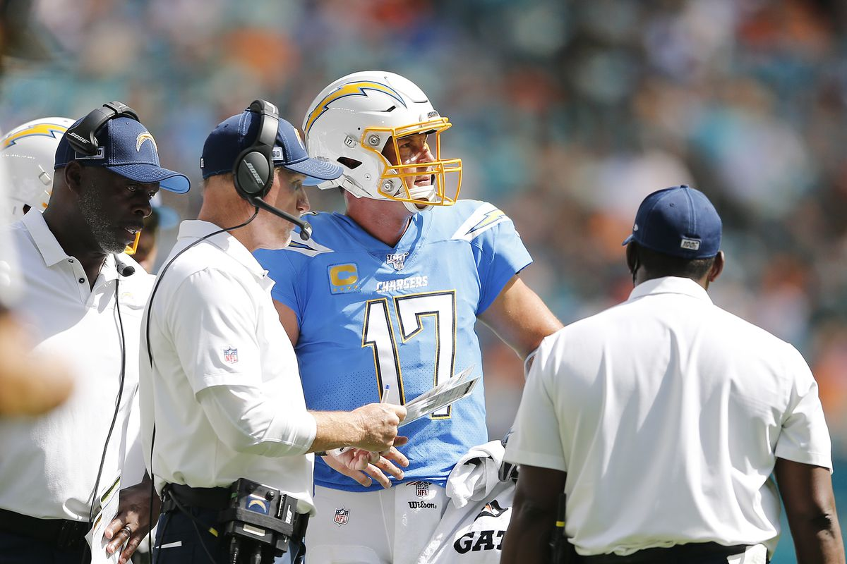 Head coach Anthony Lynn and offensive coordinator Ken Whisenhunt of the Los Angeles Chargers talks with Philip Rivers against the Miami Dolphins during the third quarter at Hard Rock Stadium on September 29, 2019 in Miami, Florida.