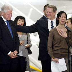 Journalist Laura Ling, right front, thanks former President Bill Clinton for his assistance in the release of herself and fellow journalist Euna Lee, right, while standing with Clinton, and Vice President Al Gore and family members at a news conference following their arrival at the Bob Hope Airport  in Los Angeles, Calif., on Wednesday.