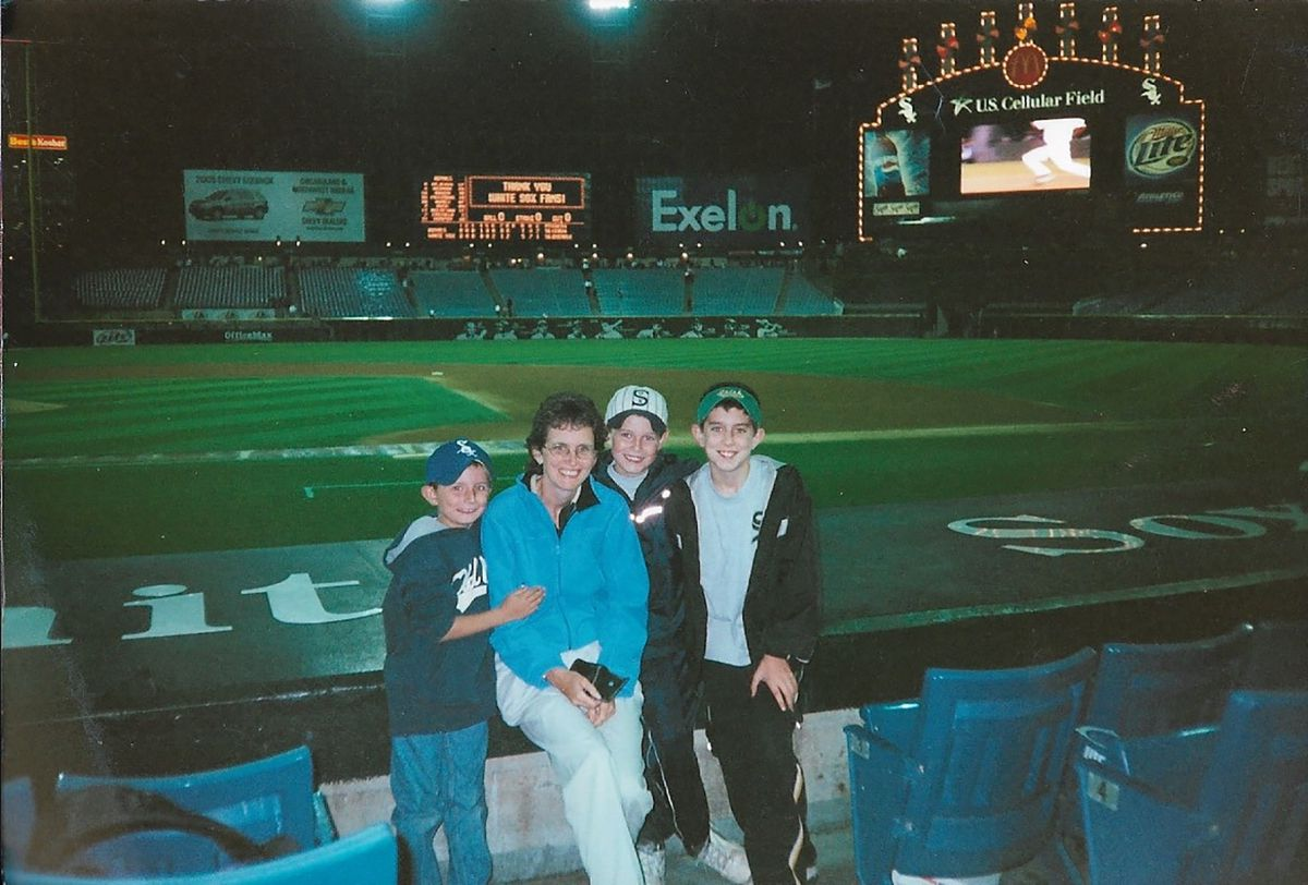 Meg Rooney with her sons (from left) Dan, Jack and Ned after a White Sox game.