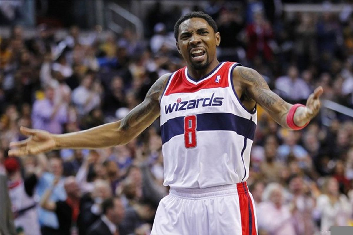 March 7, 2012; Washington, DC, USA; Washington Wizards shooting guard Roger Mason (8) celebrates on the court against the Los Angeles Lakers in the second half at Verizon Center. The Wizards won 106-101. Mandatory Credit: Geoff Burke-US PRESSWIRE