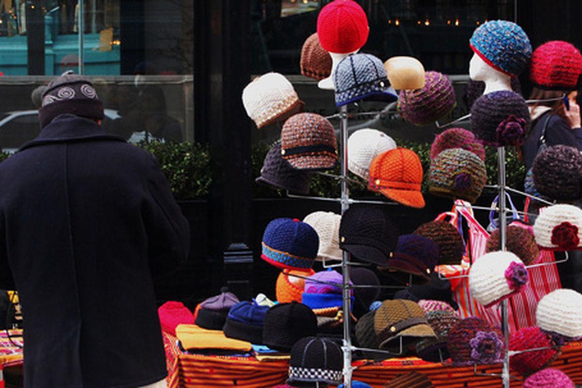 "Hat vendor via <a href=""http://www.flickr.com/photos/timschreier/4376972993/in/pool-312691@N20"">Tim Schreier</a>/Racked Flickr Pool"