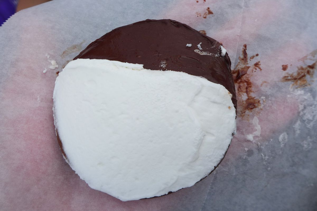 A cookie with chocolate and vanilla frosting.