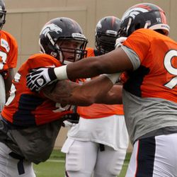 Broncos DE Derek Wolfe sees where he must go while trying to shed off teammate Sylvester Williams