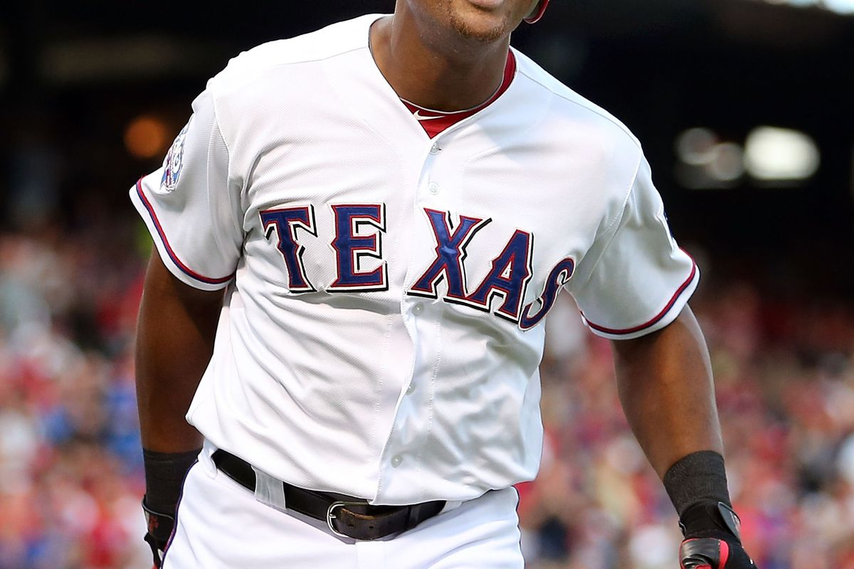 ARLINGTON, TX - AUGUST 22:  Adrian Beltre #29 of the Texas Rangers celebrates after hitting a solo homerun against the Baltimore Orioles at Rangers Ballpark in Arlington on August 22, 2012 in Arlington, Texas.  (Photo by Ronald Martinez/Getty Images)