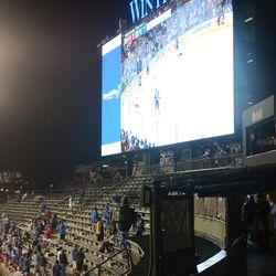 9:33 p.m. Fans in left field watching the Blackhawks -