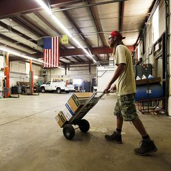 Marc Evans, public properties manager for Woods Cross, moves sprinklers for storage at the Woods Cross Public Works shop on Tuesday, Aug. 9, 2016.