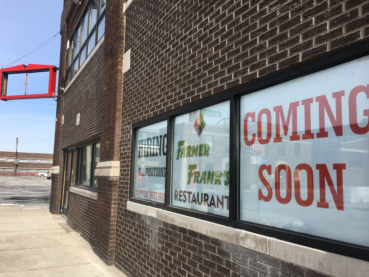 """A sign in a window reads """"Farmer Frank's Restaurant Coming Soon."""""""