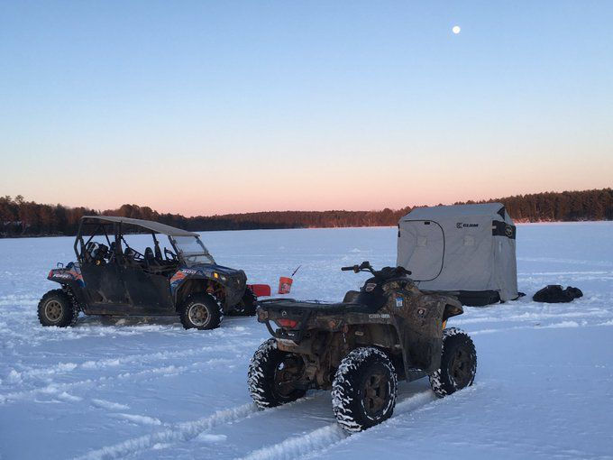 Classic scene, including the full moon, while ice fishing around Hayward, Wis. Provided by Kyle Lamm