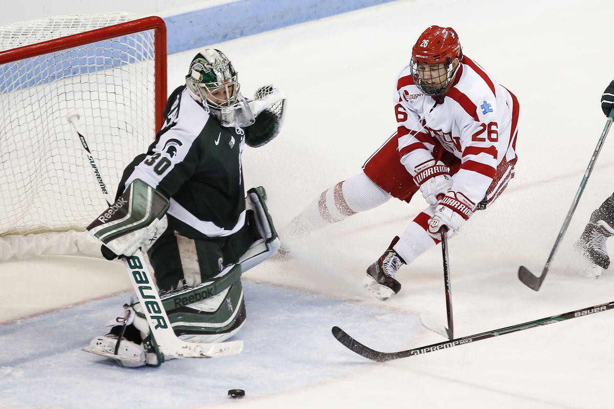Michigan State goalie Jake Hildebrand stopping Boston University's AJ Greer (26) earlier this year.