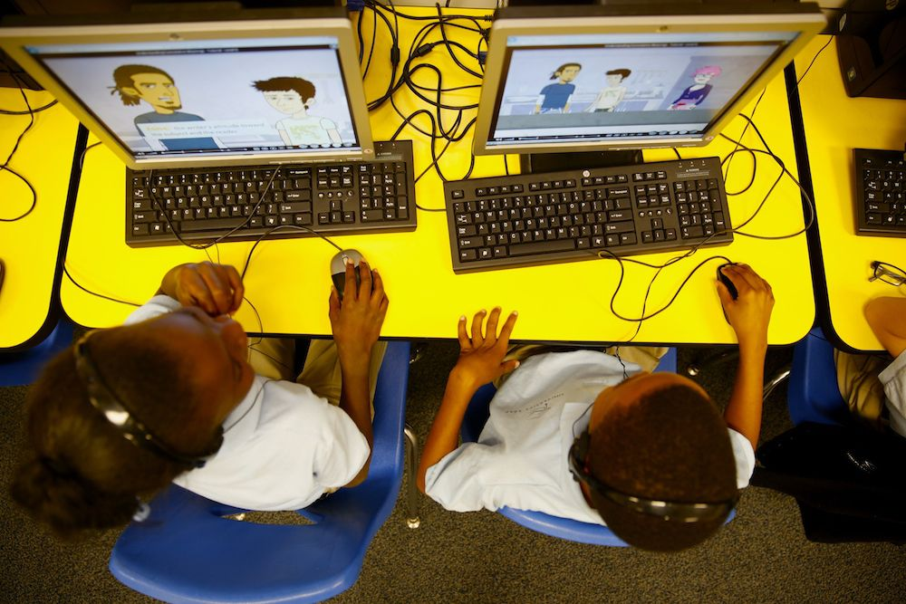Students at University Prep, a Denver elementary charter school, work on a computer-based assignment .