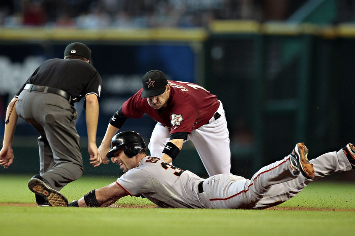 HOUSTON - AUGUST 21:  Aaron Rowand #33 of the San Frnacisco Giants is tagged out by shortstop Clint Barmes #12 as second base umpire Cory Blaser looks in at Minute Maid Park on August 21, 2011 in Houston, Texas.  (Photo by Bob Levey/Getty Images)