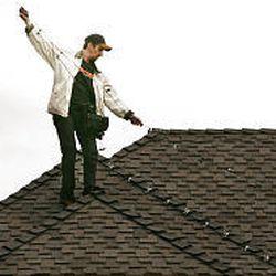 Nathan Hanks strings lights on a Draper rooftop on Nov. 8.