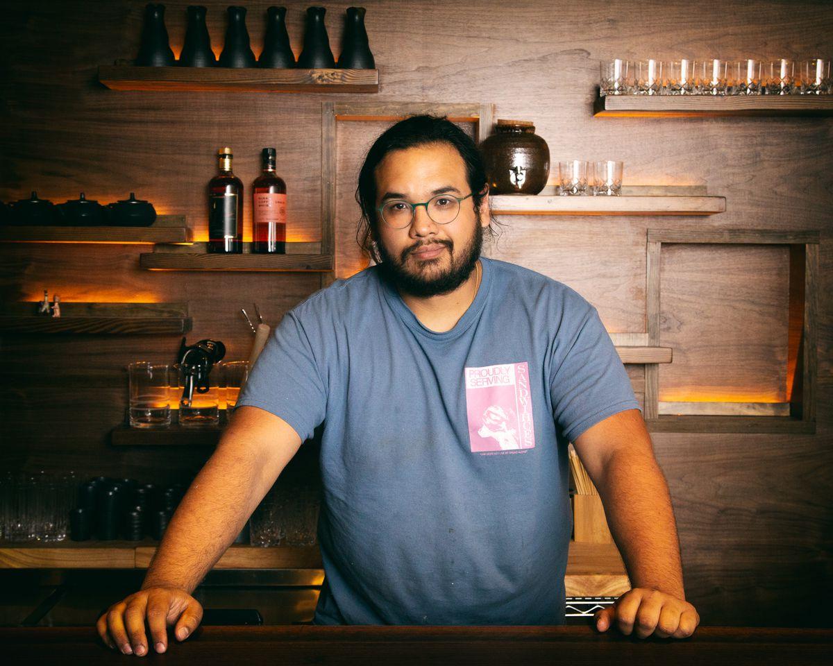 James Mark stands behind the bar at Big King